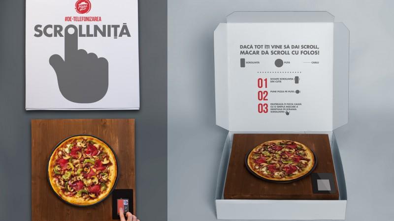 Pizza Hut si Golin au inventat scrollnita, gadget-ul care pastreaza pizza calda atunci cand dai scroll