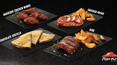 Serviciul de livrare Pizza Hut România își diversifică meniul şi oferă consumatorilor o serie de noi preparate
