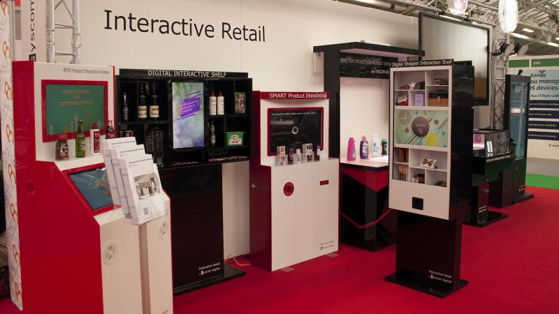Syscom Digital prin divizia de Interactive Retail - singura companie românească specializată în crearea de dispozitive inovative de retail și rafturi interactive, prezentă la Retail Expo, Londra mai 2019